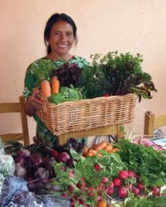 Elena with a fresh batch of organic produce