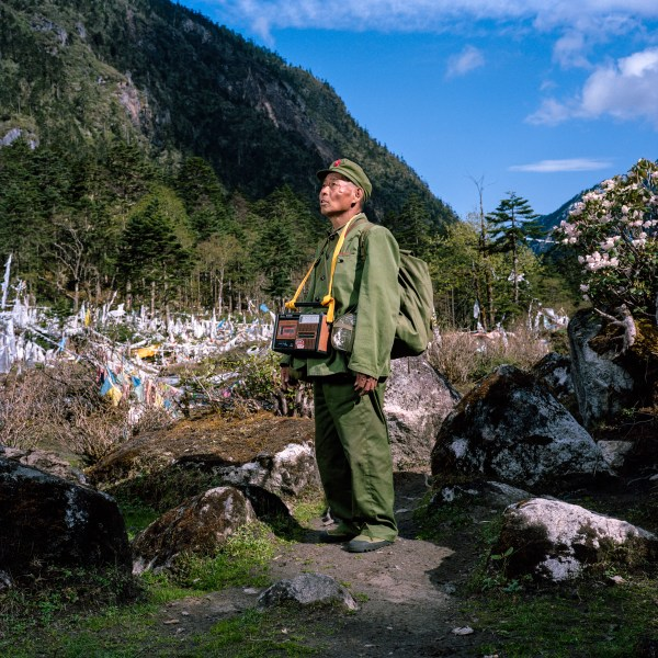 May 2012. Yunnan province, China. Professional Tibetan pilgrim (trekking around the sacred Kawa Karpo mountain on behalf of other Tibetans who cannot do it themselves).Location: At the foothill of the Duokela Pass (3600m). on the trail of the buddhist pilgrimage of the Kawa Karpo.