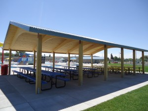 Take time to rest in the shade under one of the shelters after swimming and enjoying the sun at Rexburg Rapids