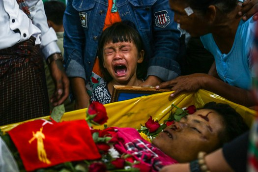 The daughter of Zwee Htet Soe, a protester who died during a demonstration against the military coup, cries during her father's funeral in Yangon, March 5, 2021. AFP