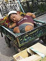 Uyghur child begs on the street in Urumchi.