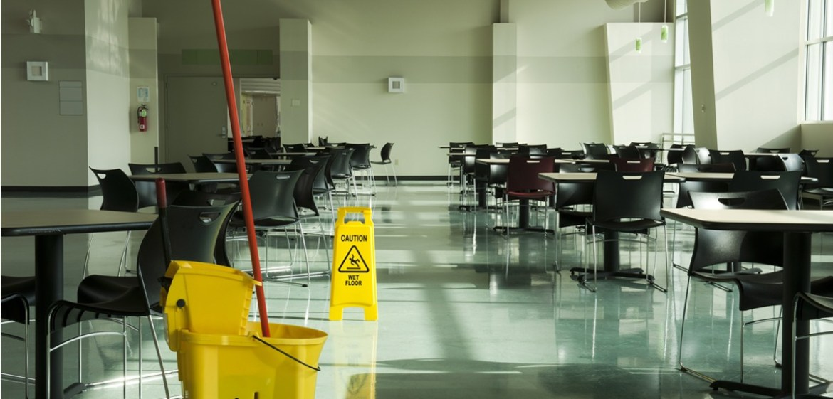 picture of a wet floor sign in a cafeteria
