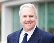 Michael Levine in a blue suit