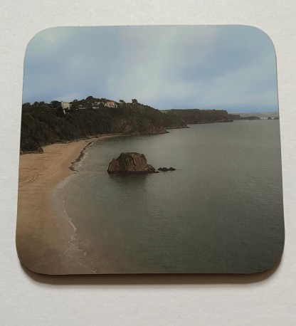 Tenby Views on a photographic hardboard coaster. Square hardboard coaster with rounded edges. Size: 90x90x3 mm Weight 0.1kg