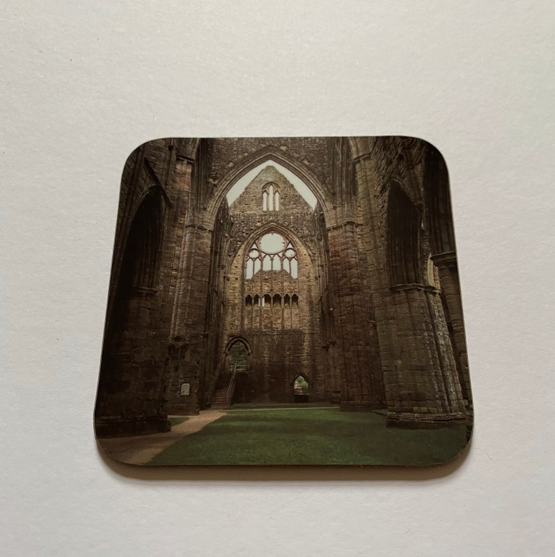 Tintern Abbey on a photographic hardboard coaster. Square hardboard coaster with rounded edges. Size: 90x90x3 mm Weight 0.1kg