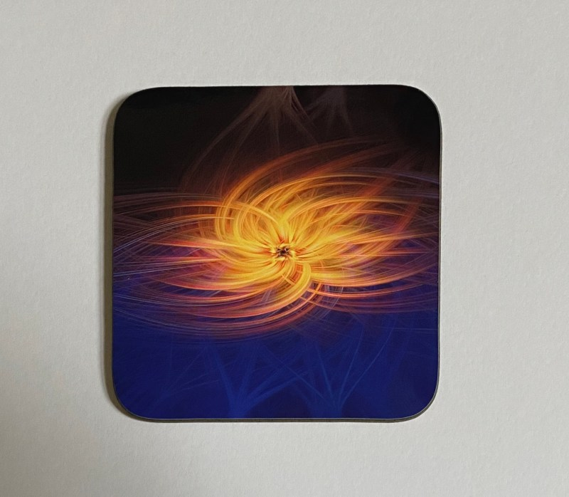 Torquay Merry Go Round Twirl Effect Art on a photographic hardboard coaster. Square hardboard coaster with rounded edges. Size: 90x90x3 mm Weight: 0.1kg