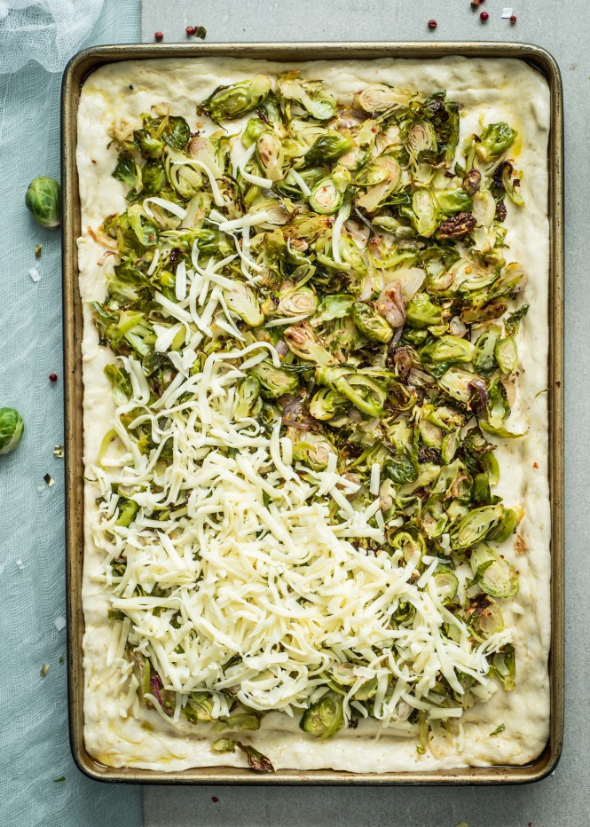 Pizza getting dressed - Sicilian-Style Pizza with Roasted Brussels Sprouts and Banana Peppers
