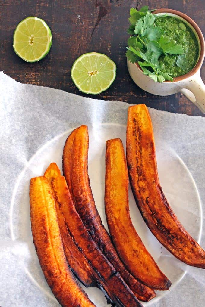Fried green plantains with aji sauce