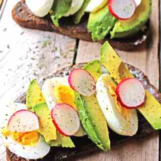 Smorrebrod with egg, avocado, and radish