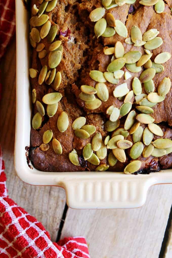 Whole grain pumpkin cranberry rye bread! A healthier take on the classic pumpkin quick bread using whole grain dark rye flour. Moist and delicious!