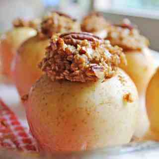Maple pecan steel cut oatmeal baked apples recipe! This simple and healthy vegan breakfast will make you feel warm and cozy all morning long! Vegan, vegetarian, dairy free.