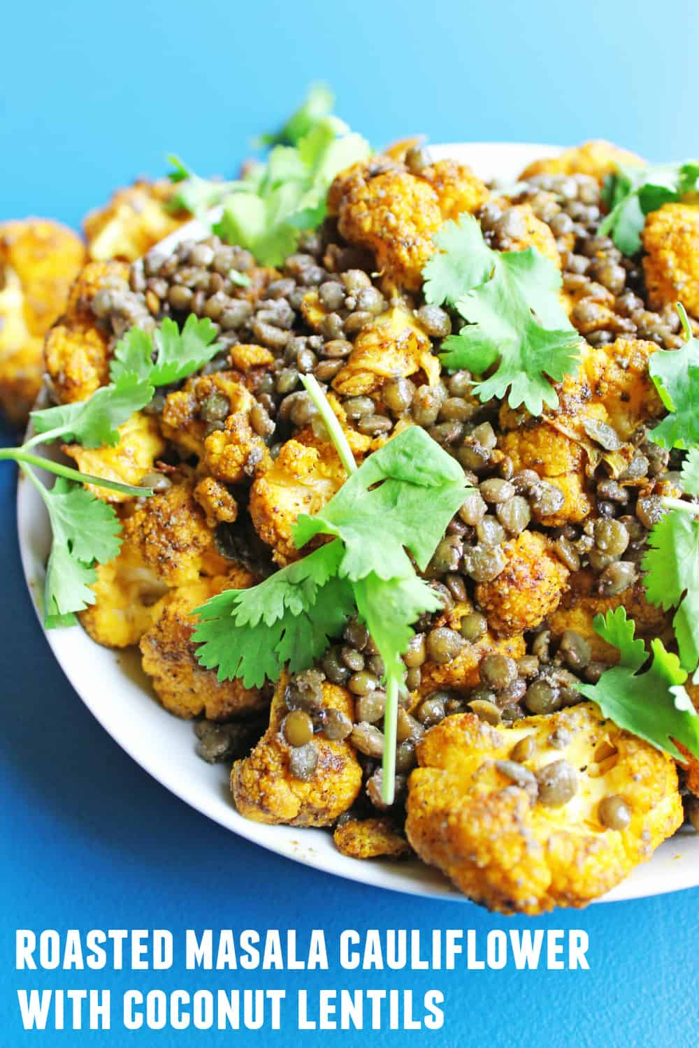 Roasted masala cauliflower with coconut lentils! A super simple, vegan recipe perfect for a weeknight meal. Serve as a delicious side, or with rice and naan bread as an entree. Vegan, vegetarian, dairy free, gluten free. SO GOOD!