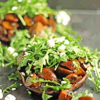 Stacked ale mushrooms with arugula and goat cheese