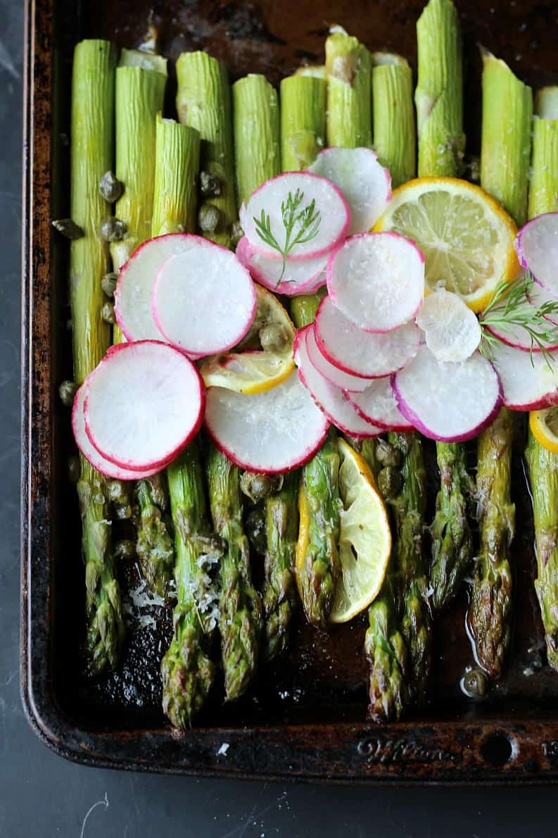 Roasted asparagus with lemon and capers + 15 Farmers market recipes to make in May! Delicious, vegetarian, (mostly) healthy spring/summer recipes made with fresh, seasonal produce from your local farmers market or CSA bin. Eat local! // Rhubarbarians