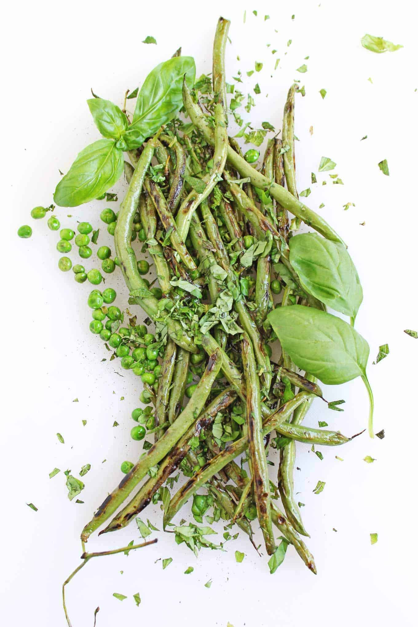 Sauteed pea and green bean salad + 15 Farmers market recipes to make in May! Delicious, vegetarian, (mostly) healthy spring/summer recipes made with fresh, seasonal produce from your local farmers market or CSA bin. Eat local! // Rhubarbarians