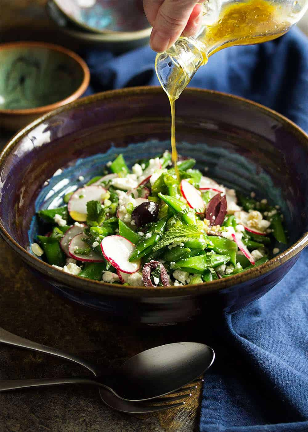 Spring radish snap pea greek salad + 15 Farmers market recipes to make in May! Delicious, vegetarian, (mostly) healthy spring/summer recipes made with fresh, seasonal produce from your local farmers market or CSA bin. Eat local! // Rhubarbarians