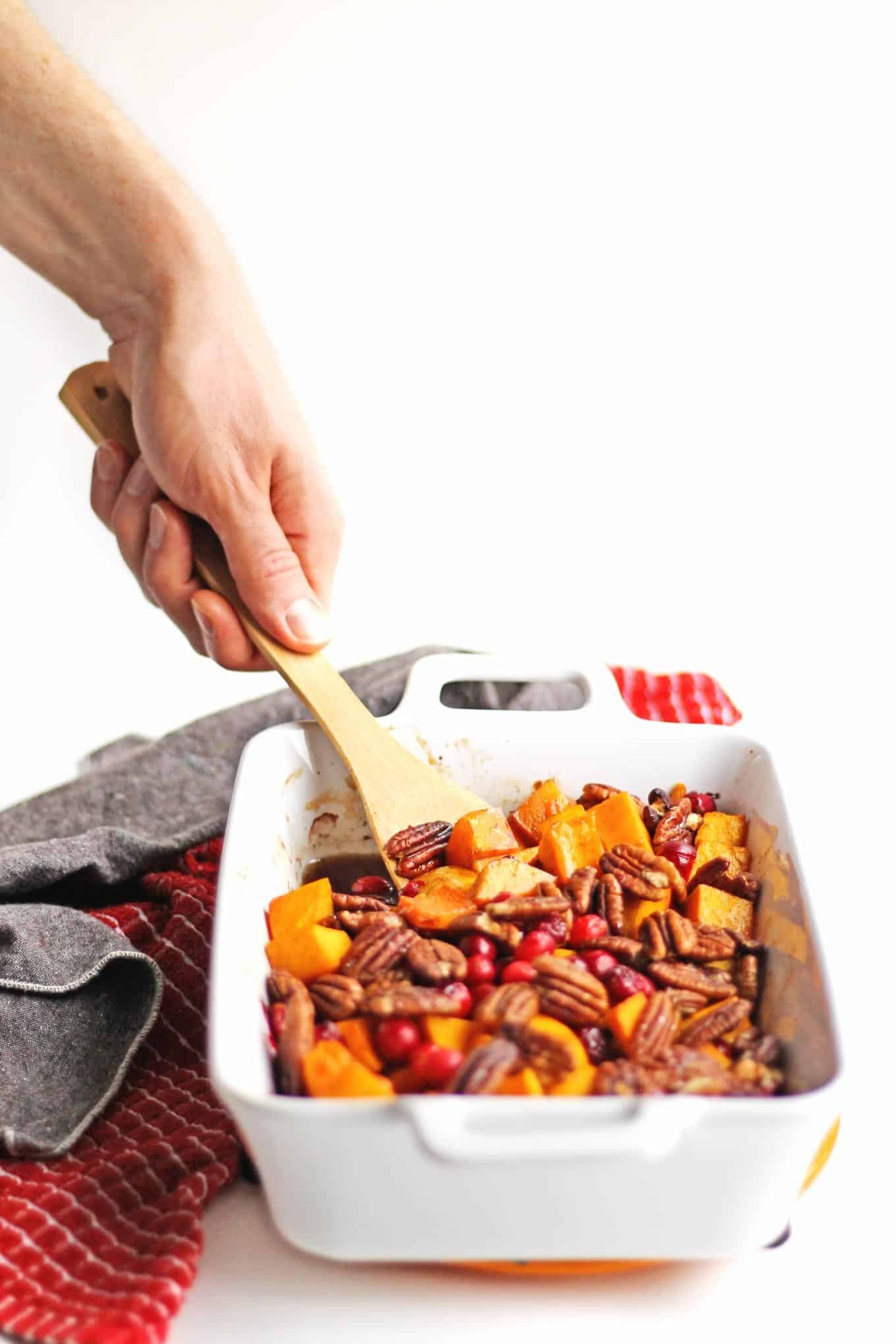 Vegan maple pecan roasted butternut squash and cranberries! Simple, Thanksgiving, Christmas, fall, holiday side dish. Roasted maple cinnamon butternut squash. // Rhubarbarians #sidedish #thanksgiving #christmas #holiday #vegan #butternutsquash #fallrecipe