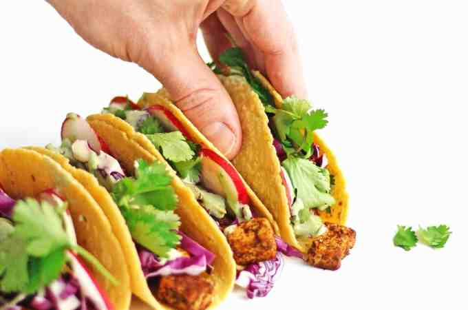 Loaded vegan tofu tacos with spicy cilantro crema