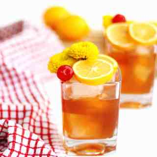 Simple, meyer lemon old fashioned recipe! A bright and refreshing spin on the classic old fashioned cocktail with rye, bourbon, or whiskey. // Rhubarbarians