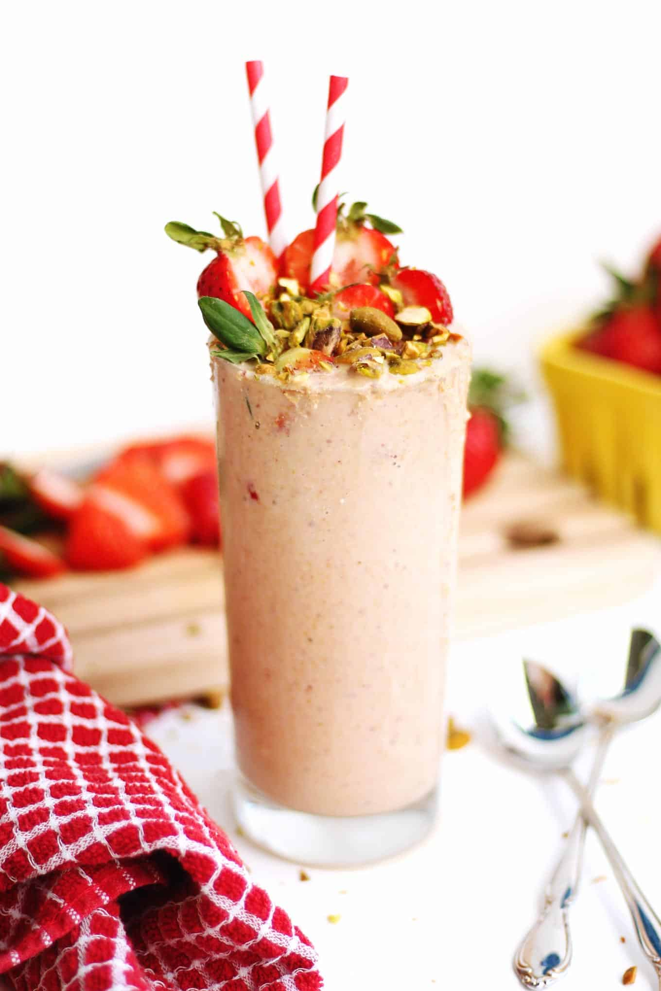 Creamy vegan strawberry smoothie with pistachios recipe! This dairy free pistachio strawberry smoothie is extra thick and nutty from real nuts! // Rhubarbarians