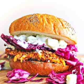 Carrot tahini quinoa veggie burger with tzatziki and purple slaw