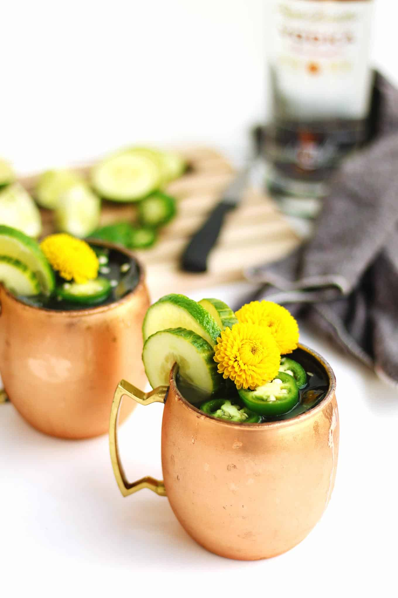 Jalapeno cucumber moscow mule recipe! A spicy, flavorful twist on the classic moscow mule cocktail with vodka, ginger beer, and lime. // Rhubarbarians