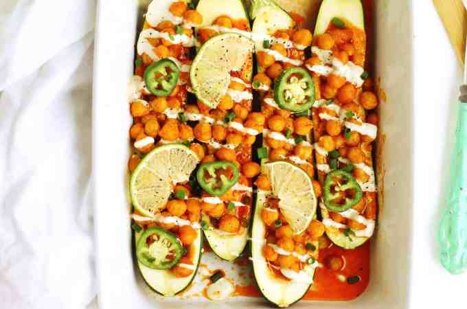 Spicy buffalo chickpea zucchini boats recipe! This 30-minute vegetarian dinner is perfect for meatless monday or an easy weeknight meal. // Rhubarbarians
