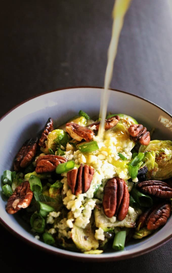 30-minute, warm brussels sprouts salad recipe! A healthy, vegetarian salad loaded with pecans, apples, and topped with an apple cider ginger dressing. // Rhubarbarians // Meatless Monday / Main dish salad / fall salad / autumn salad / #fallsalad #vegetarian #brusselssprouts #meatlessmonday #rhubarbarians