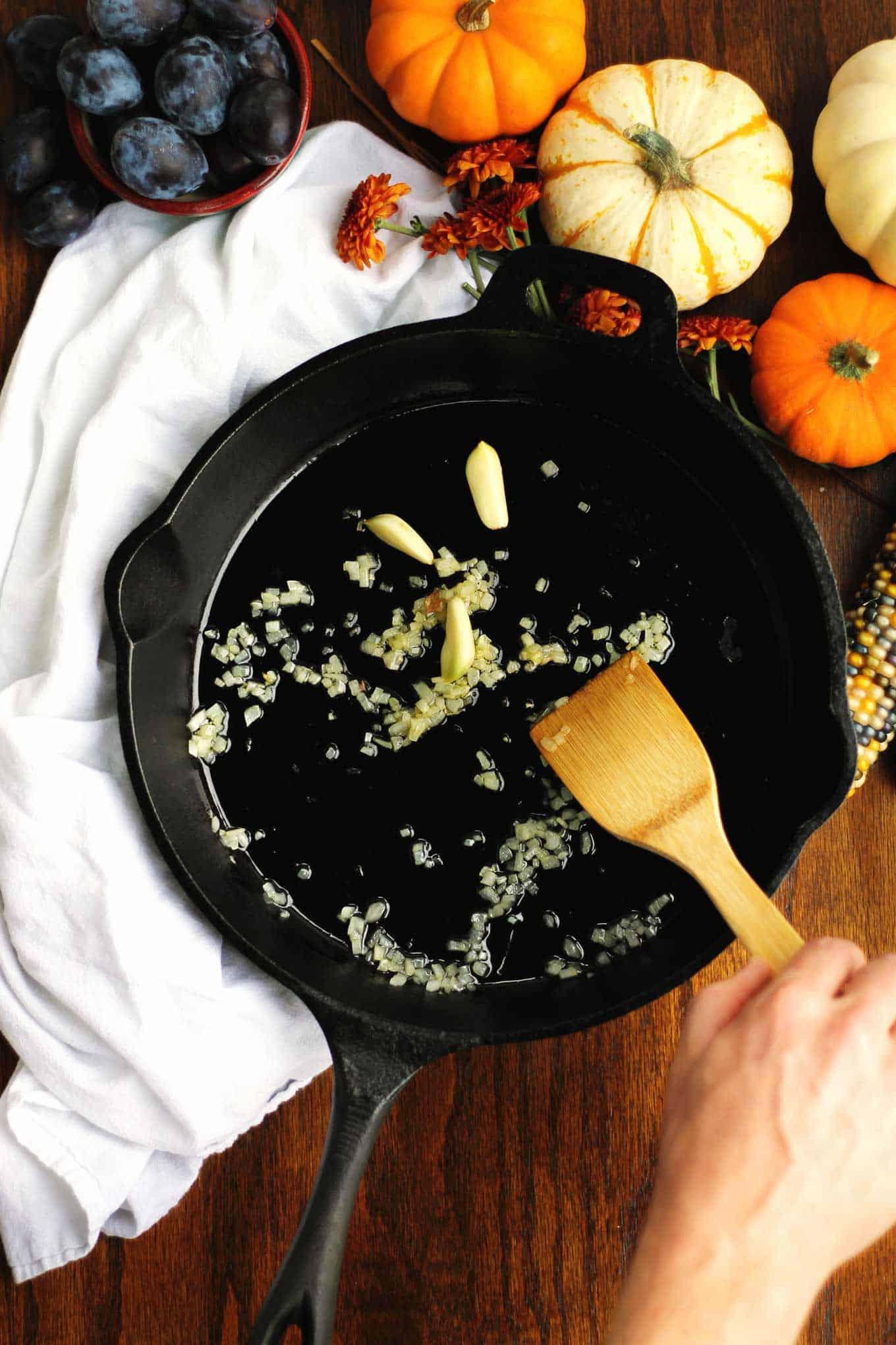 sauteed shallot and garlic in a black skillet