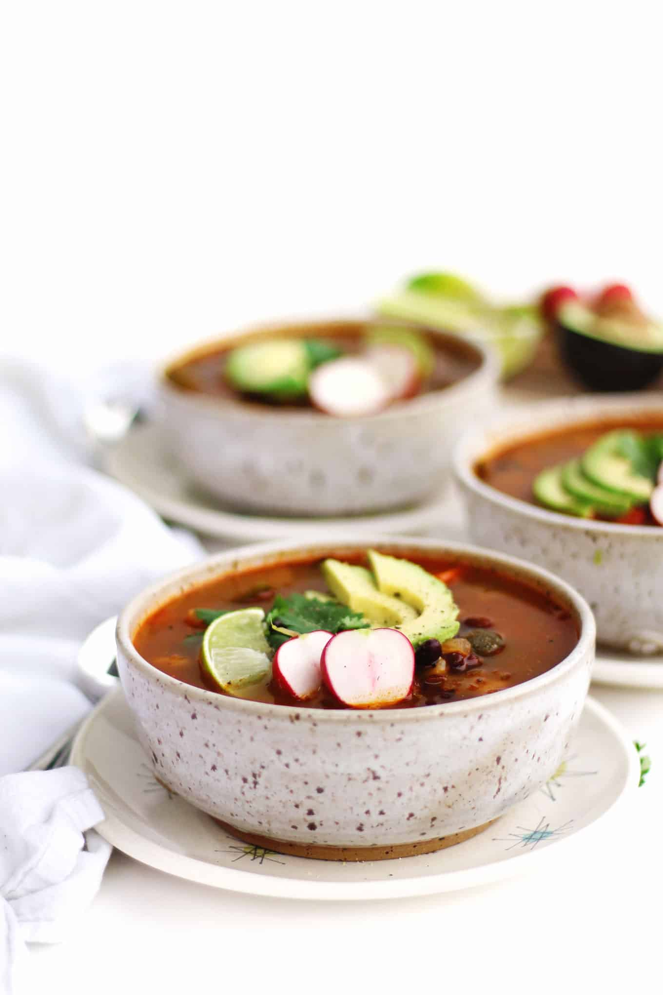 bowl of posole with toppings