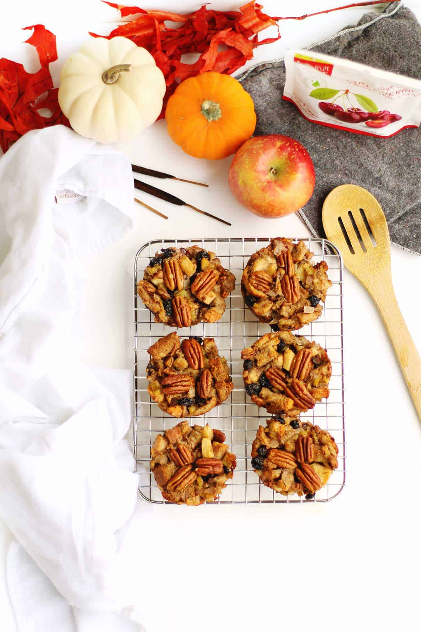 stuffing muffins with wooden spoon