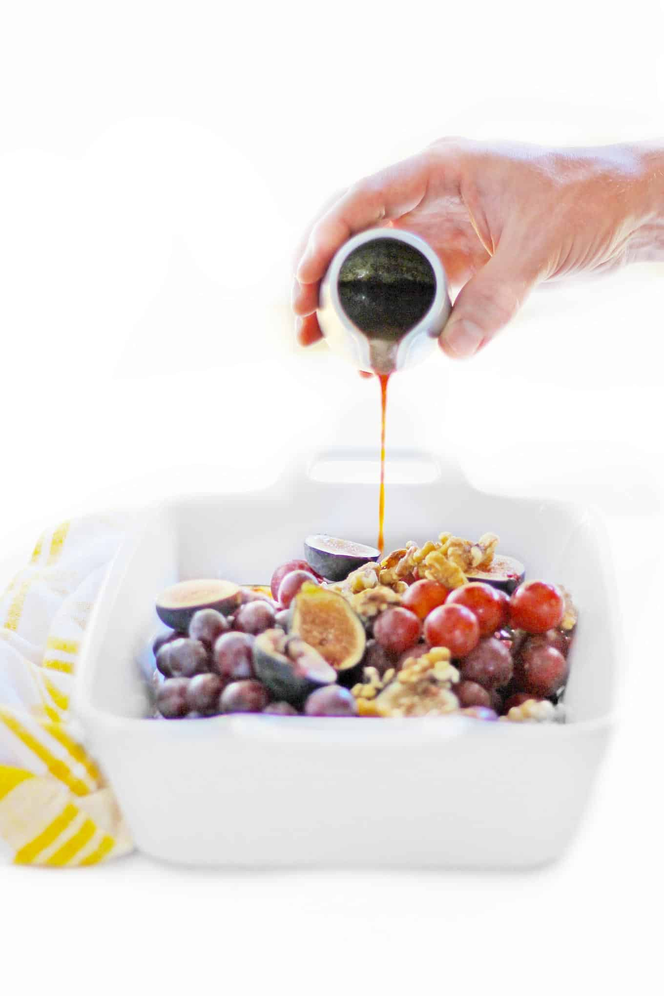 drizzling syrup on fruit