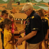 1st Junee Scout Group Akela Jackie Starr showing the Trophy to Cub Scout Annabelle Howarth