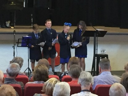 Junee North Public Students doing a Reading at the Junee Combined Church Service at the Athenium Theatre