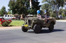 VRA member Janelle Ford riding a military jeep in the Junee Street Parade