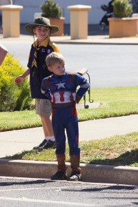 Superhero Edward O'Malley and Cub Scout Jarrell Stanyer watching the Junee Street Parade