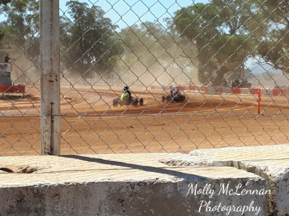 Gordon Benny puts an outside pass at turn 4 on Warren Badger's yellow #23 at Illabo Motorsports Park