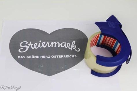 ausgedrucktes Steiermark Herz mit Paketklebeband