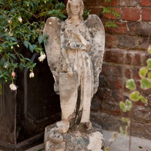 ANTIQUE STONE STATUE OF AN ANGEL