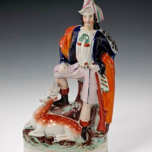 ANTIQUE STAFFORDSHIRE FIGURE OF A HUNTSMAN & STAG
