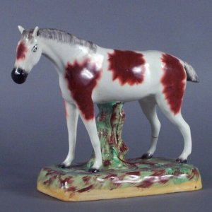 ANTIQUE STAFFORDSHIRE FIGURE OF A LARGE HORSE