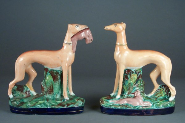 ANTIQUE STAFFORDSHIRE FIGURES OF STANDING GREYHOUNDS