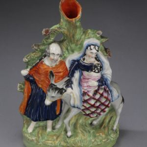 ANTIQUE STAFFORDSHIRE FIGURE FLIGHT FROM EGYPT