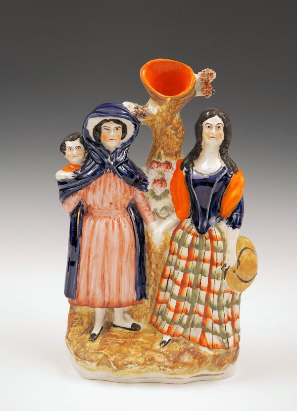 ANTIQUE STAFFORDSHIRE FIGURE OF THE FORTUNE TELLER