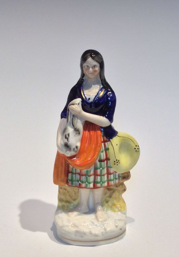 ANTIQUE STAFFORDSHIRE FIGURE OF A LADY AND RABBIT