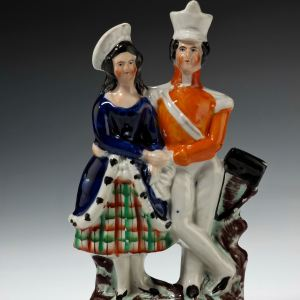 ANTIQUE STAFFORDSHIRE FIGURE OF A SOLDIER AND GIRL