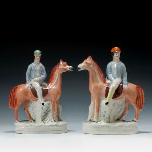 PAIR OF ANTIQUE STAFFORDSHIRE FIGURES OF MOUNTED JOCKEYS