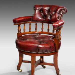 ANTIQUE LEATHER COVERED REVOLVING DESK CHAIR
