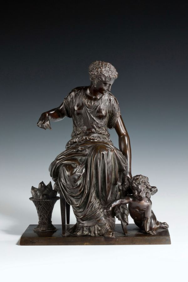 ANTIQUE BRONZE GROUP OF A WOMAN AND CUPID