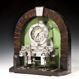 VINTAGE SILVER PLATED STEAM TRAIN CLOCK IN TUNNEL